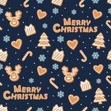 Modelo inconsútil de la Navidad Galletas y copos de nieve del pan de jengibre en azul marino Fotografía de archivo libre de regalías