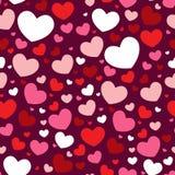 Modelo inconsútil de la tarjeta del día de San Valentín con los corazones Fotografía de archivo