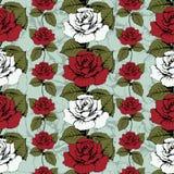 Modelo inconsútil de las rosas de las flores Rosas rojas y blancas tejidas, adornado Fondo azul con los modelos floridos Brotes t Foto de archivo