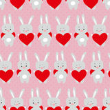 Modelo inconsútil de las tarjetas del día de San Valentín lindas con los conejos de la historieta con el corazón Fotografía de archivo libre de regalías