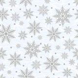 Modelo inconsútil de los Años Nuevos y de la Navidad Copos de nieve en un b ondulado ilustración del vector