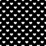 Modelo inconsútil de los corazones blancos en un fondo negro Fotos de archivo libres de regalías