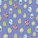 Modelo inconsútil de los huevos de Pascua en fondo azul stock de ilustración