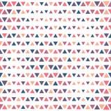 Modelo inconsútil de los triángulos del color del vector Fotos de archivo libres de regalías