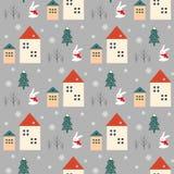 Modelo inconsútil del árbol, de los copos de nieve, del conejo y de las casas de Navidad en fondo gris Imagen de archivo