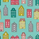 Modelo inconsútil del vector con las casas lindas en fondo azul libre illustration
