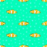 Modelo inconsútil del vector con los pescados y las burbujas amarillos en el fondo verde Imagen de archivo