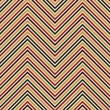 Modelo inconsútil en colores tradicionales de la Navidad La diagonal brillante de los colores de Chevron alinea el fondo abstract Imagen de archivo