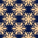 Modelo inconsútil floral de oro en fondo azul Fotografía de archivo