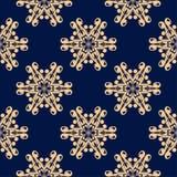 Modelo inconsútil floral de oro en fondo azul Imagen de archivo libre de regalías