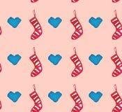 Modelo inconsútil hermoso de la acuarela de la Navidad con los calcetines y los corazones imágenes de archivo libres de regalías