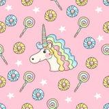Modelo inconsútil lindo con el caramelo, las estrellas, los anillos de espuma y unicornio