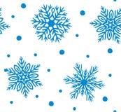 Modelo inconsútil simple con los copos de nieve exhaustos de la mano libre illustration