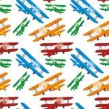 Modelo inconsútil de aeroplanos coloreados Foto de archivo libre de regalías