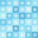 Modelo inconsútil plano del invierno de los copos de nieve y de los cuadrados del diseño Imágenes de archivo libres de regalías