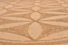 Modelo linear en la arena Imagen de archivo