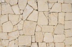 Modelo loco poner crema de la pared de piedra de pavimentación Imágenes de archivo libres de regalías