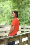 Modelo masculino com camisa alaranjada fora Fotografia de Stock Royalty Free