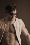 Modelo masculino con las cortinas Foto de archivo libre de regalías