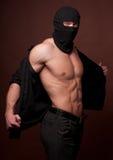 Modelo masculino em uma máscara imagem de stock royalty free
