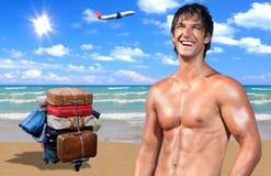 Modelo masculino joven en la playa Fotos de archivo libres de regalías