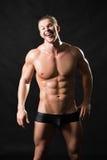 Modelo masculino musculoso Foto de archivo libre de regalías