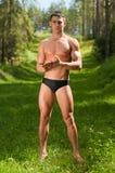 Modelo masculino na floresta Fotos de Stock Royalty Free