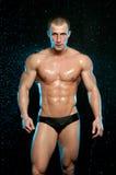 Modelo masculino no estúdio do aqua fotografia de stock royalty free