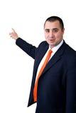 Modelo masculino que desgasta um terno que aponta a um branco para trás Foto de Stock Royalty Free