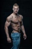 Modelo Muscled com tinta Imagens de Stock Royalty Free