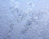 Modelo natural escarchado en ventana del invierno Foto de archivo libre de regalías