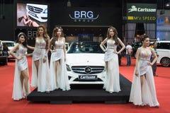 Modelo no identificado con el coche del grupo del BRG en la expo internacional 2015 del motor de Tailandia Foto de archivo libre de regalías