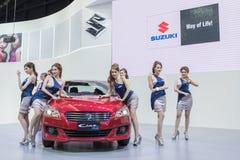 Modelo no identificado con el coche del suzuki en la expo internacional 2015 del motor de Tailandia Imágenes de archivo libres de regalías