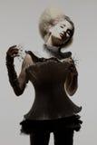 Modelo no vestido e no cabelo da expressão foto de stock