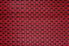 Modelo plástico rojo de las esteras Foto de archivo