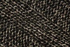 Modelo que hace punto del hilado suave caliente de lana gris Foto de archivo libre de regalías