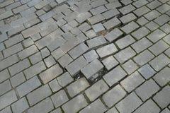 Modelo quebrado del pavimento de adoquín de la calle Foto de archivo