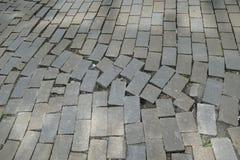 Modelo quebrado del pavimento de adoquín de la calle Fotos de archivo libres de regalías