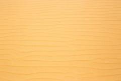 Modelo rojo de la textura de las dunas de arena del desierto Fotografía de archivo
