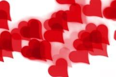 Modelo rojo del bokeh de los corazones Imagen de archivo libre de regalías
