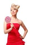 Modelo rubio lindo del estilo de la muñeca con el caramelo Imagen de archivo libre de regalías