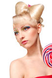 Modelo rubio lindo del estilo de la muñeca con el caramelo Imagenes de archivo