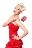 Modelo rubio lindo del estilo de la muñeca con el caramelo Fotografía de archivo
