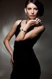 Modelo 'sexy' bonito no vestido preto Imagens de Stock Royalty Free