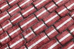 Modelo urbano del Grunge de la bandera de Letonia Imagen de archivo