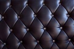 Modelo y superficie del cuero del sofá con el cristal b Fotos de archivo libres de regalías