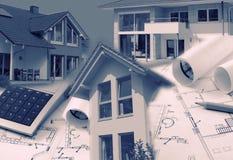 Modelos, casas e calculadora Imagens de Stock Royalty Free