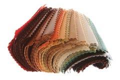 Modelos de diversas telas de tapicería de los colores Fotos de archivo