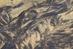 Modelos de la arena en un rivulet Imagenes de archivo