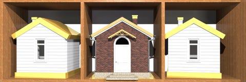 Modelos de la casa en el estante Imagenes de archivo